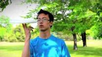 Solving a Rubik's Cube One-Handed While Spinning a Frisbee
