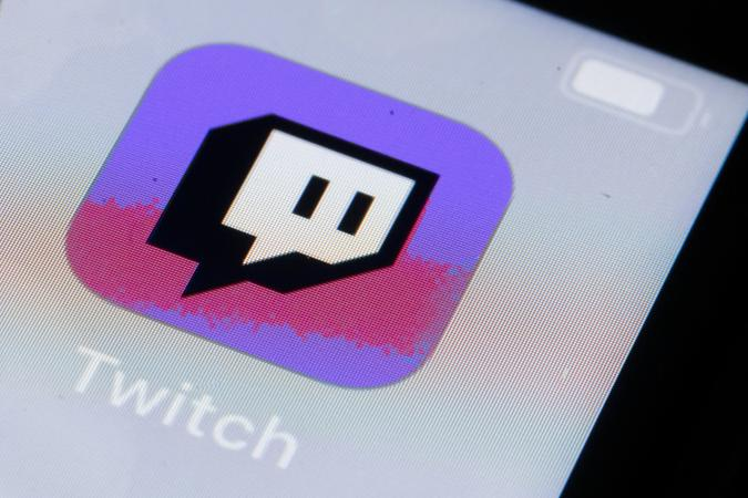 BERLIN, GERMANY - OCTOBER 11: In this photo illustration the logo of live streaming video platform Twitch is displayed on a smartphone on October 11, 2019 in Berlin, Germany. (Photo Illustration by Thomas Trutschel/Photothek via Getty Images)