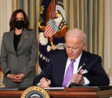 In early action, Biden tries to make good on pledge to heal America's racial divide