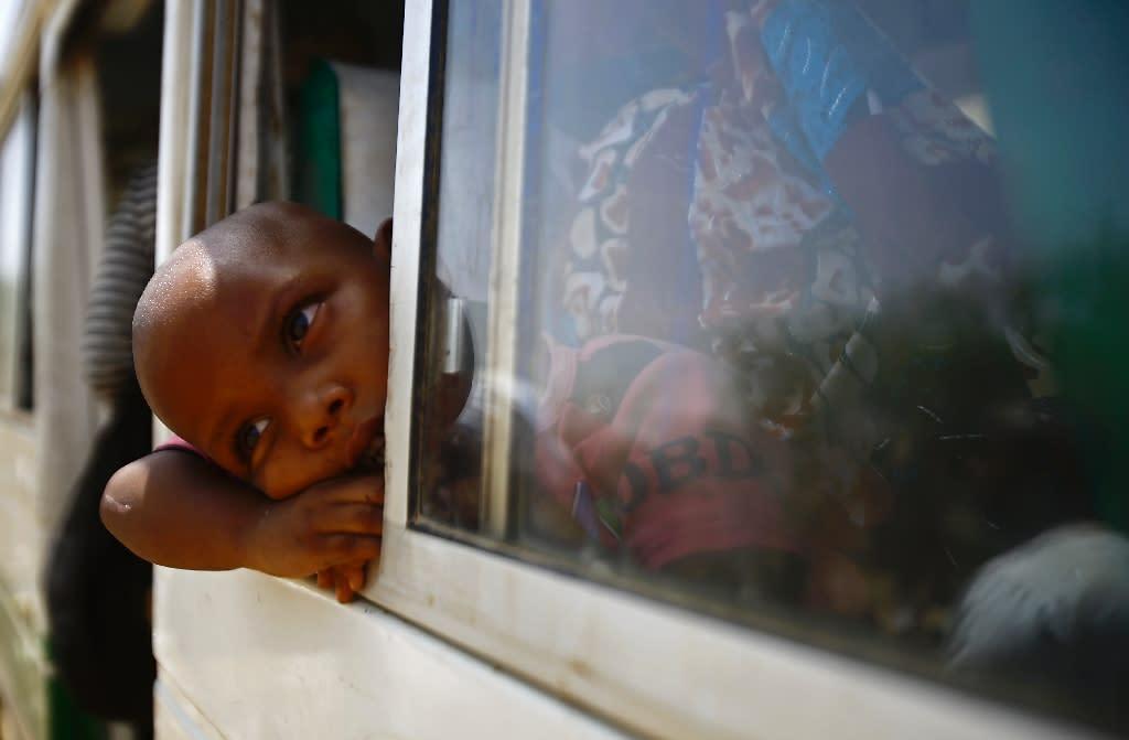 Migrants from Eritrea sit on a bus at the al-Laffa border crossing in Sudan's eastern Kassala state on the Eritrea-Sudan border on May 2, 2017 (AFP Photo/ASHRAF SHAZLY)
