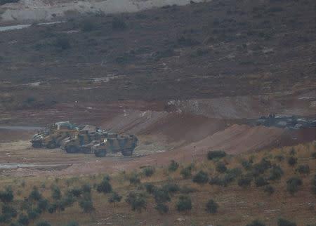 Turkish military vehicles are seen on the Turkish-Syrian border line in Reyhanli, Hatay province, Turkey, October 13, 2017. REUTERS/Osman Orsal