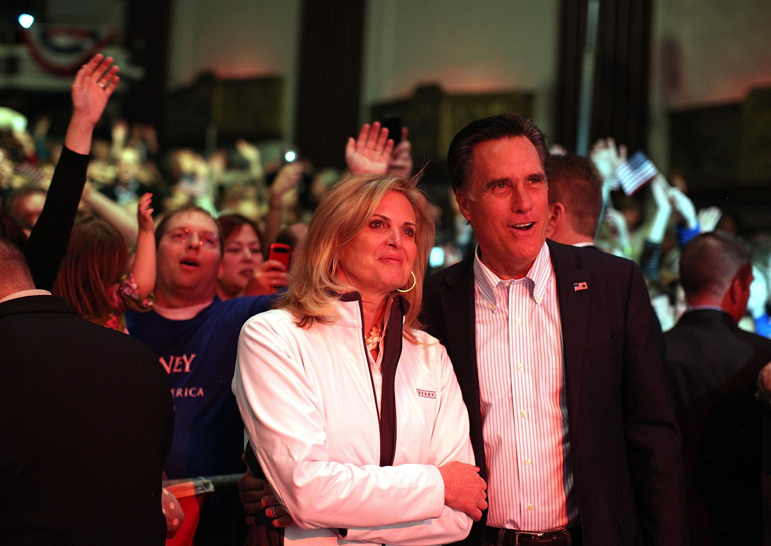 ROYAL OAK, MI - FEBRUARY 27: Republican presidential candidate and former Massachusetts Gov. Mitt Romney (R) and his wife Ann Romney look on as musician Kid Rock performs during a campaign rally at the Royal Oak Theatre on February 27, 2012 in Royal Oak, Michigan. Michigan residents will go to the polls on February 28 to vote for their choice in the Republican presidential race. (Photo by Justin Sullivan/Getty Images)