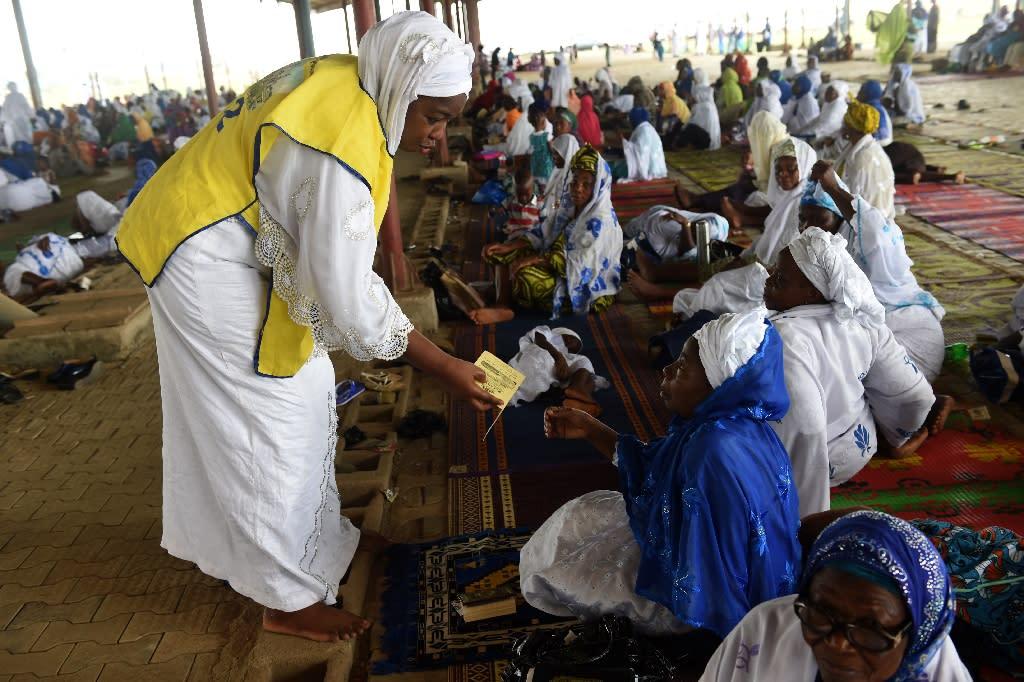 Worshippers at Sunday prayer at the Nasrul-lahi-li Fathi Society of Nigeria, where Islam is going evangelical (AFP Photo/PIUS UTOMI EKPEI)