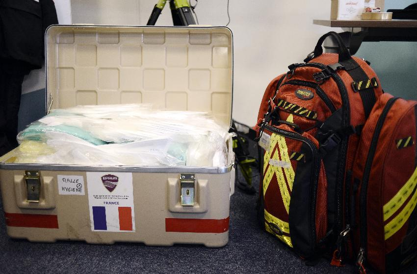 Equipment is laid out during a meeting between emergency medical staff and the health minister before their departure to Guinea on October 31, 2014, north of Paris