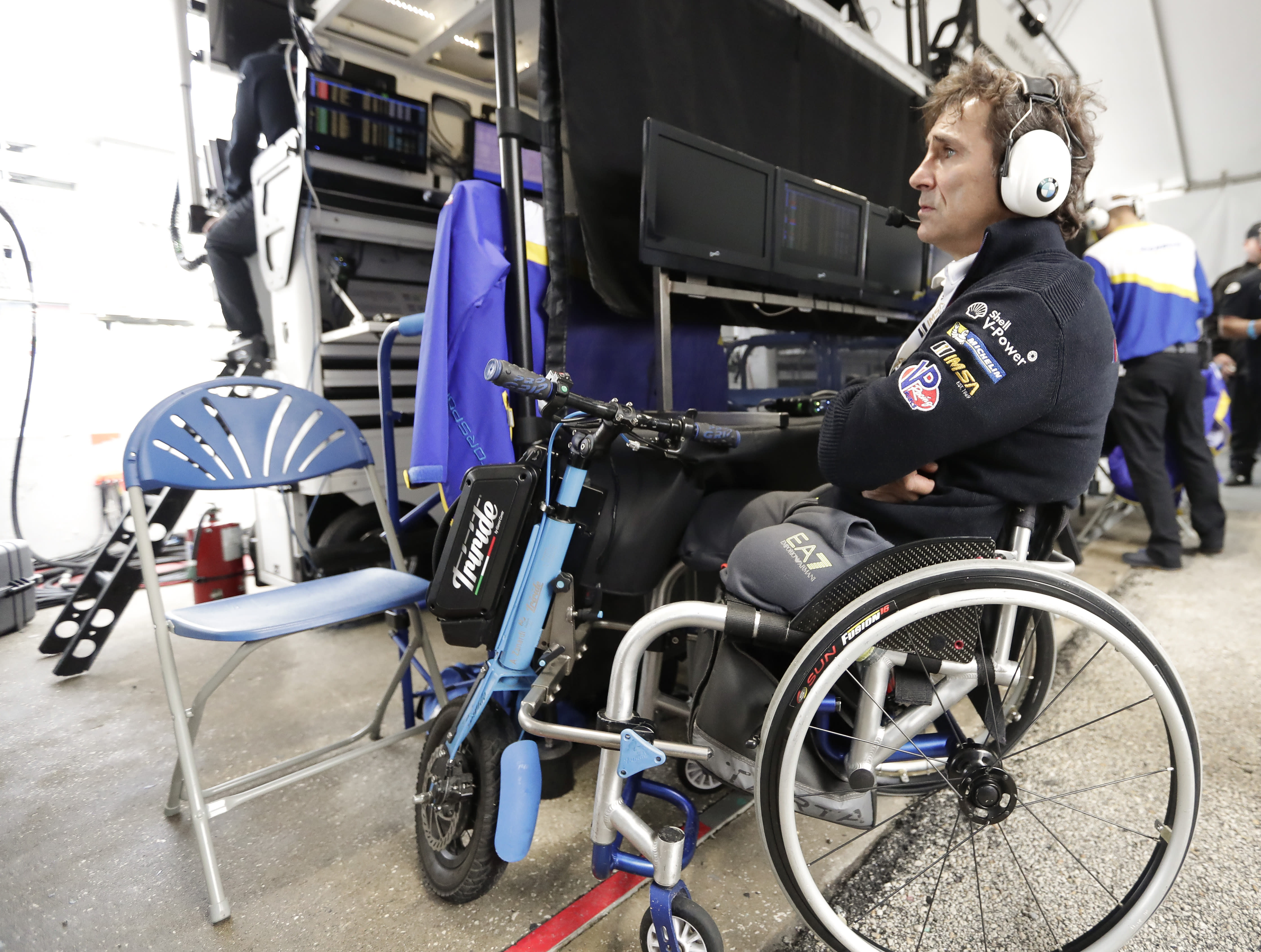 Alex Zanardi watches a video monitor in his pit stall during a practice session for the IMSA 24 hour race at Daytona International Speedway, Thursday, Jan. 24, 2019, in Daytona Beach, Fla. (AP Photo/John Raoux)