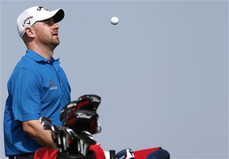 Lee of Scotland plays with the ball on the third hole during the Abu Dhabi Golf championship