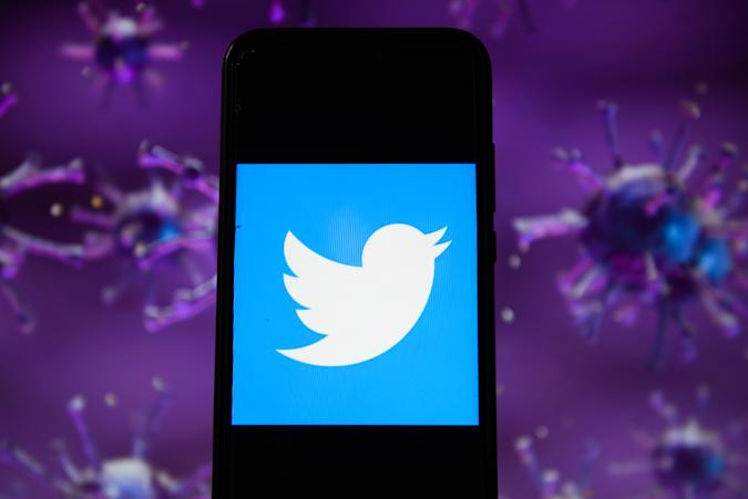 POLAND - 2020/04/28: In this photo illustration a Twitter logo displayed on a smartphone with a COVID 19 sample image in the background. (Photo Illustration by Omar Marques/SOPA Images/LightRocket via Getty Images)