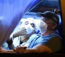 14 test positive among US plane evacuees from Japan virus ship