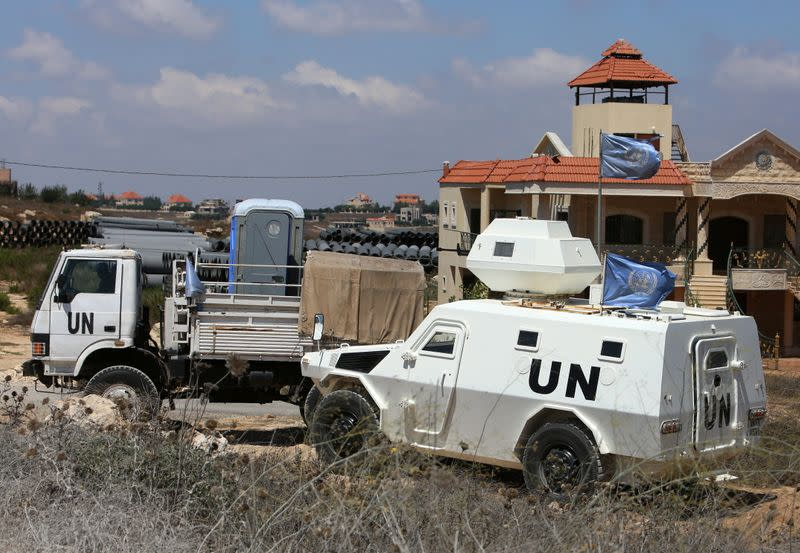 UN vehicles are seen in Houla village near the Lebanese-Israeli border, in southern Lebanon