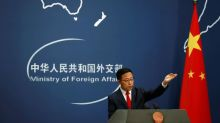 China's state media condemn raids on Chinese journalists in Australia