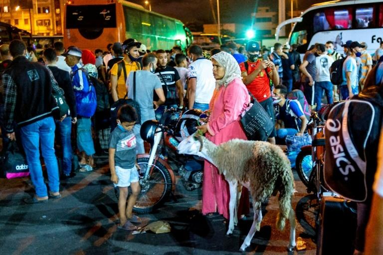 Travel restrictions slapped on eight cities over the weekend sparked chaos across Morocco, as people crowded bus and train stations attempting to travel to be with family for Eid al-Adha before measures took effect (AFP Photo/Rizkou ABDELMJID)