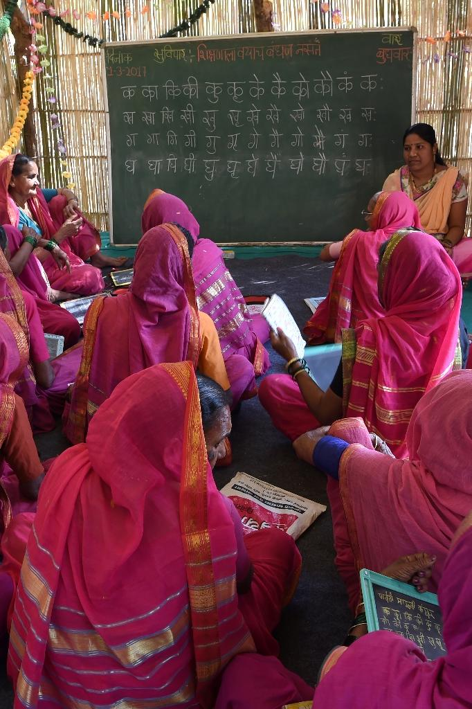 """The distinctive pink uniform worn by students at the Aajibaichi Shala, or """"school for grannies"""" helps combat discrimination (AFP Photo/Indranil MUKHERJEE)"""