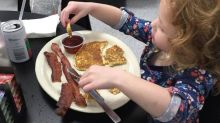 This kid eating breakfast with her 'Daddy Doll' will melt your heart