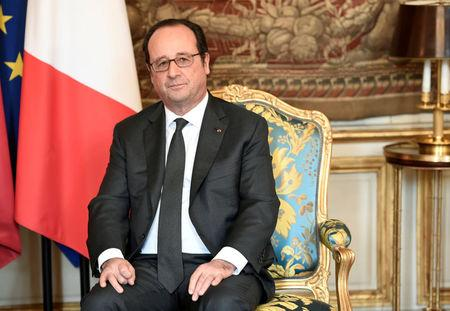 French President Francois Hollande attends a meeting with Mali's President Ibrahim Boubacar Keita at the Elysee Palace in Paris