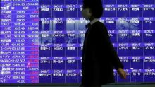 Asian shares jump on hopes for low rates, oil up on cyber attack