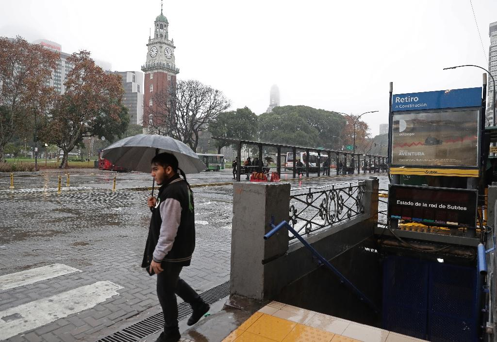 A man walks next to a closed subway station in downtown Buenos Aires during a power outage (AFP Photo/ALEJANDRO PAGNI)