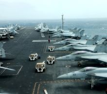U.S. aircraft carrier strike group sails through Strait of Hormuz