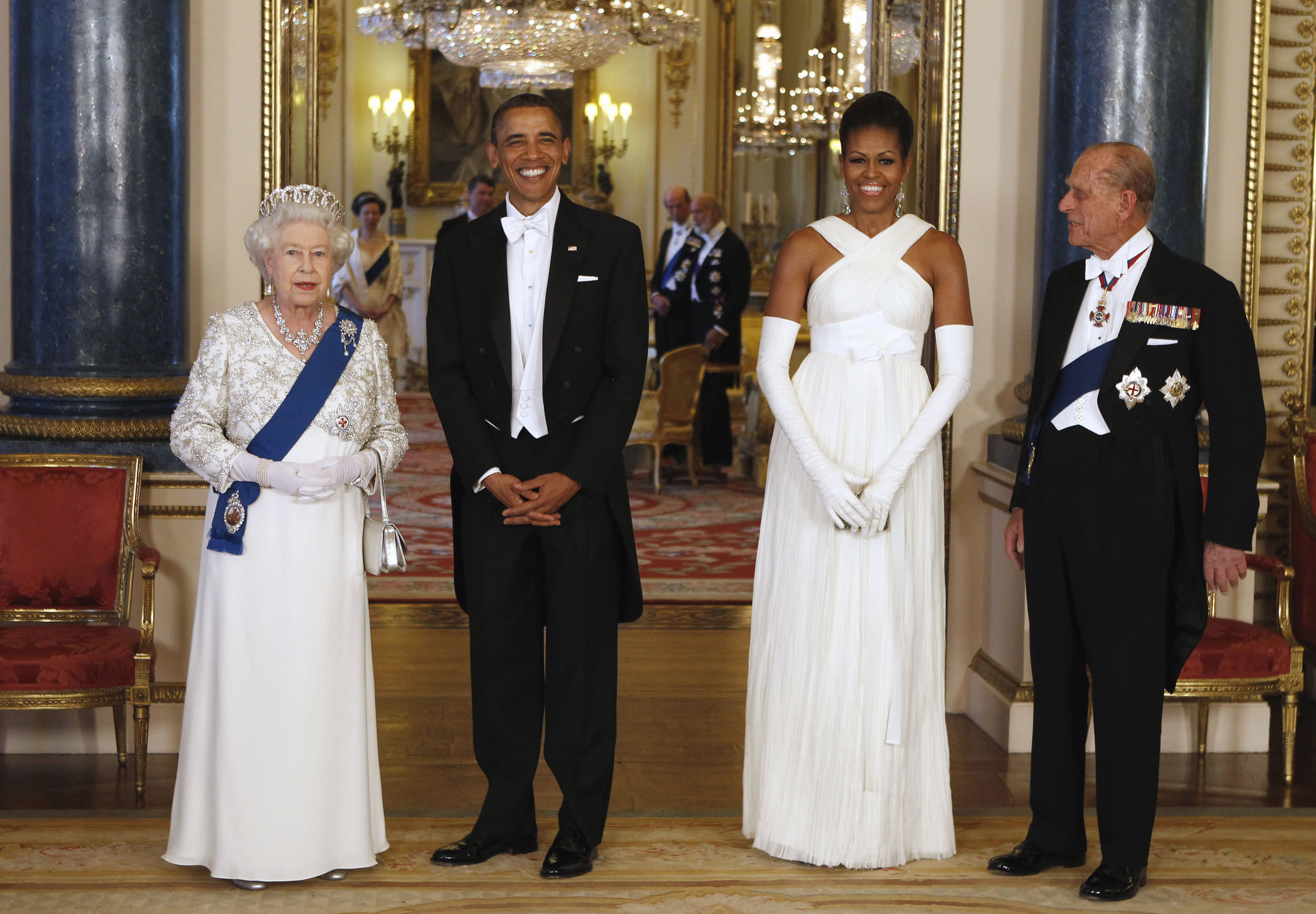 FILE - In this May 24, 2011 file photo President Barack Obama, first lady Michelle Obama, Queen Elizabeth II, and Prince Philip pose for photographers prior to a dinner hosted by the queen at Buckingham Palace in London. With his departure from Berlin on Friday, Nov. 18, 2016 Obama will leave Europe for the last time as U.S. President. (Larry Downing/Pool photo via AP, file)