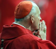 The Latest: Cardinal calls McCarrick punishment 'important'