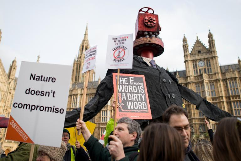 Activists attend an anti-fracking rally outside the Houses of Parliament in central London on January 26, 2015 (AFP Photo/Leon Neal)