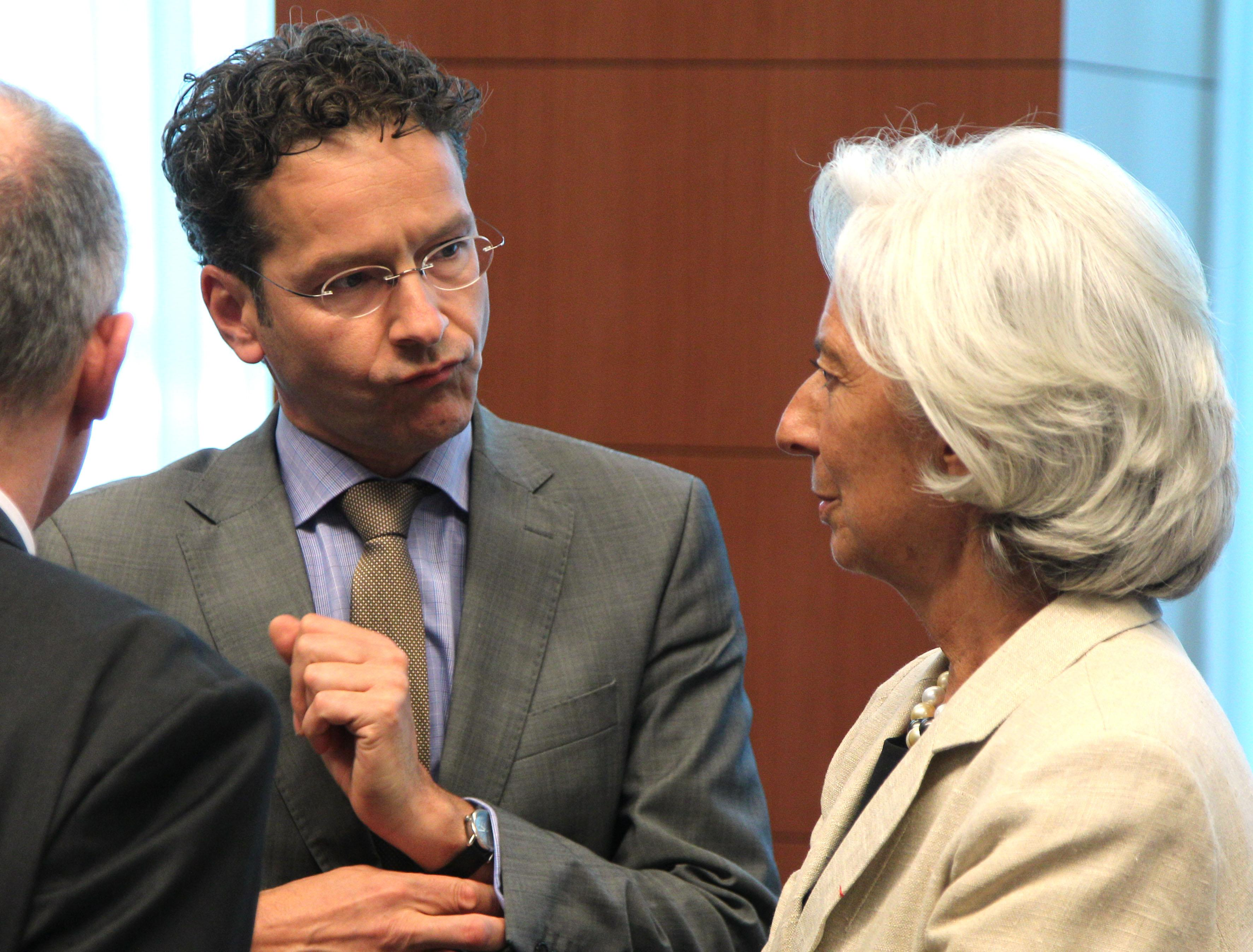 International Monetary Fund managing director Christine Lagarde, right, talks with Dutch Finance Minister and chairman of the Eurogroup Jeroen Dijsselbloem, during the Eurogroup meeting, at the European Council building in Brussels, Monday, July 8, 2013. The finance ministers of the 17 European countries that use the euro are expected to approve the release of another installment of the rescue funds that Greece has been relying on since May 2010. (AP Photo/Yves Logghe)