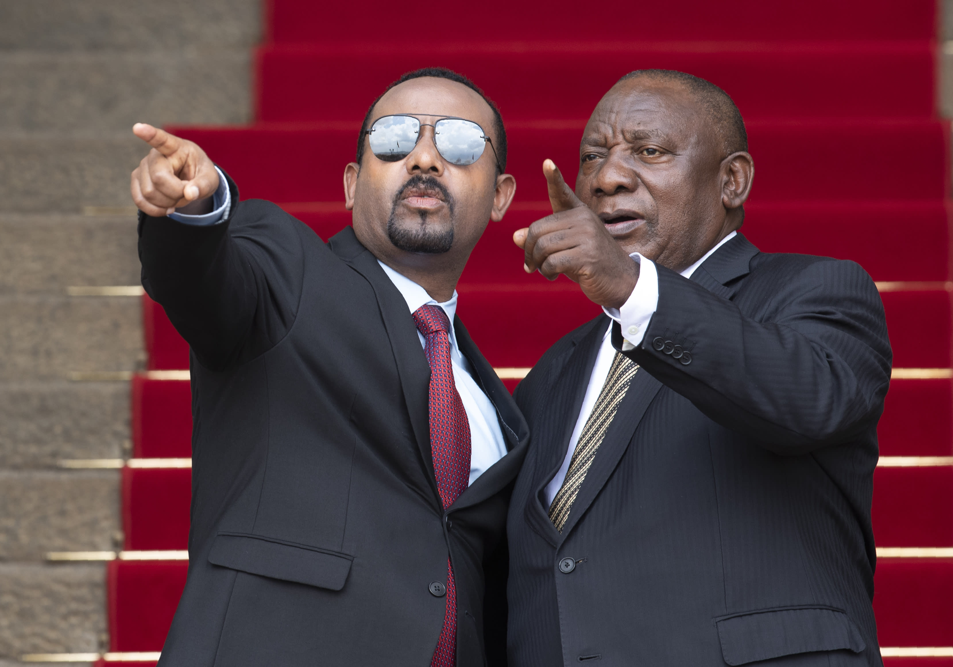 South African President Cyril Ramaphosa, left, with Ethiopia's Prime Minister Abiy Ahmed gestures as they pose for a photo prior to their talks at the Union Building in Pretoria, South Africa, Sunday, Jan. 12, 2020. (AP Photo/Themba Hadebe)