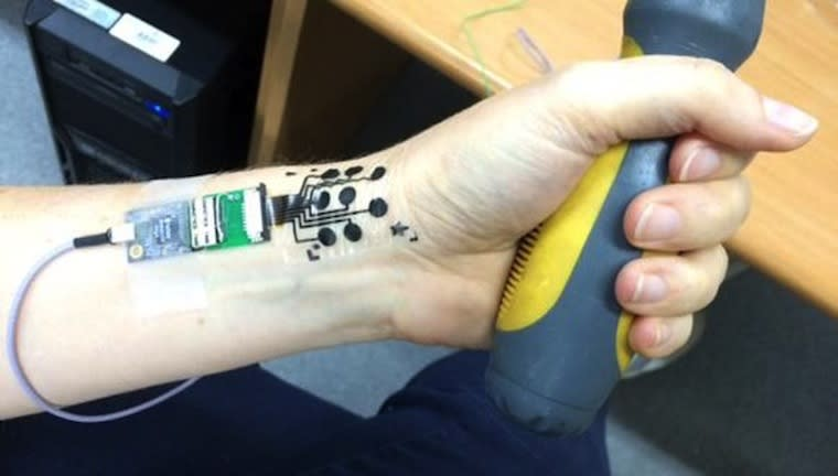 Ultrathin electric 39 tattoo 39 can monitor muscles and more for Electric hand tattoo