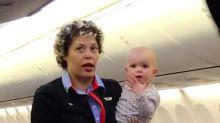 Southwest flight attendant carries passenger's baby