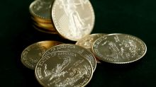 Gold slips, but safe-haven demand keeps prices above $1,300