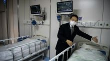 Shanghai virus hospital tries array of treatments in 'big test'