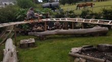 Uncle makes nephew's dream come true when he builds roller coaster in the back garden - using scrap metal, wood and plastic pipes