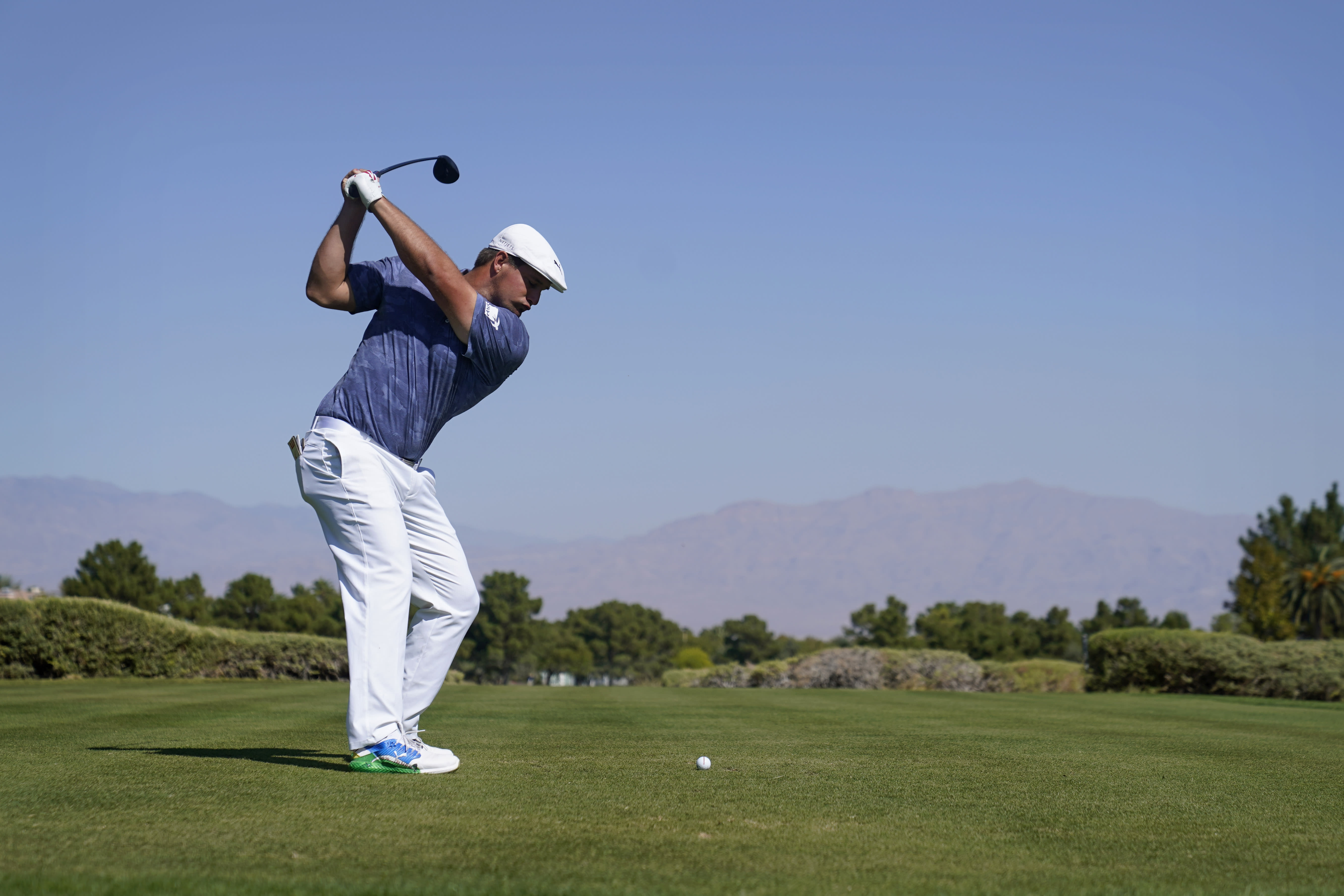 Bryson DeChambeau hits off the 10th tee during the final round of Shriners Hospitals for Children Open golf tournament Sunday, Oct. 11, 2020, in Las Vegas. (AP Photo/John Locher)