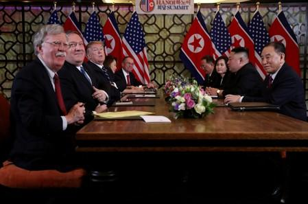 FILE PHOTO: FILE PHOTO: North Korea's leader Kim Jong Un and U.S. President Donald Trump attend the extended bilateral meeting in the Metropole hotel during the second North Korea-U.S. summit in Hanoi