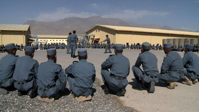 French train Afghan army and police to take over