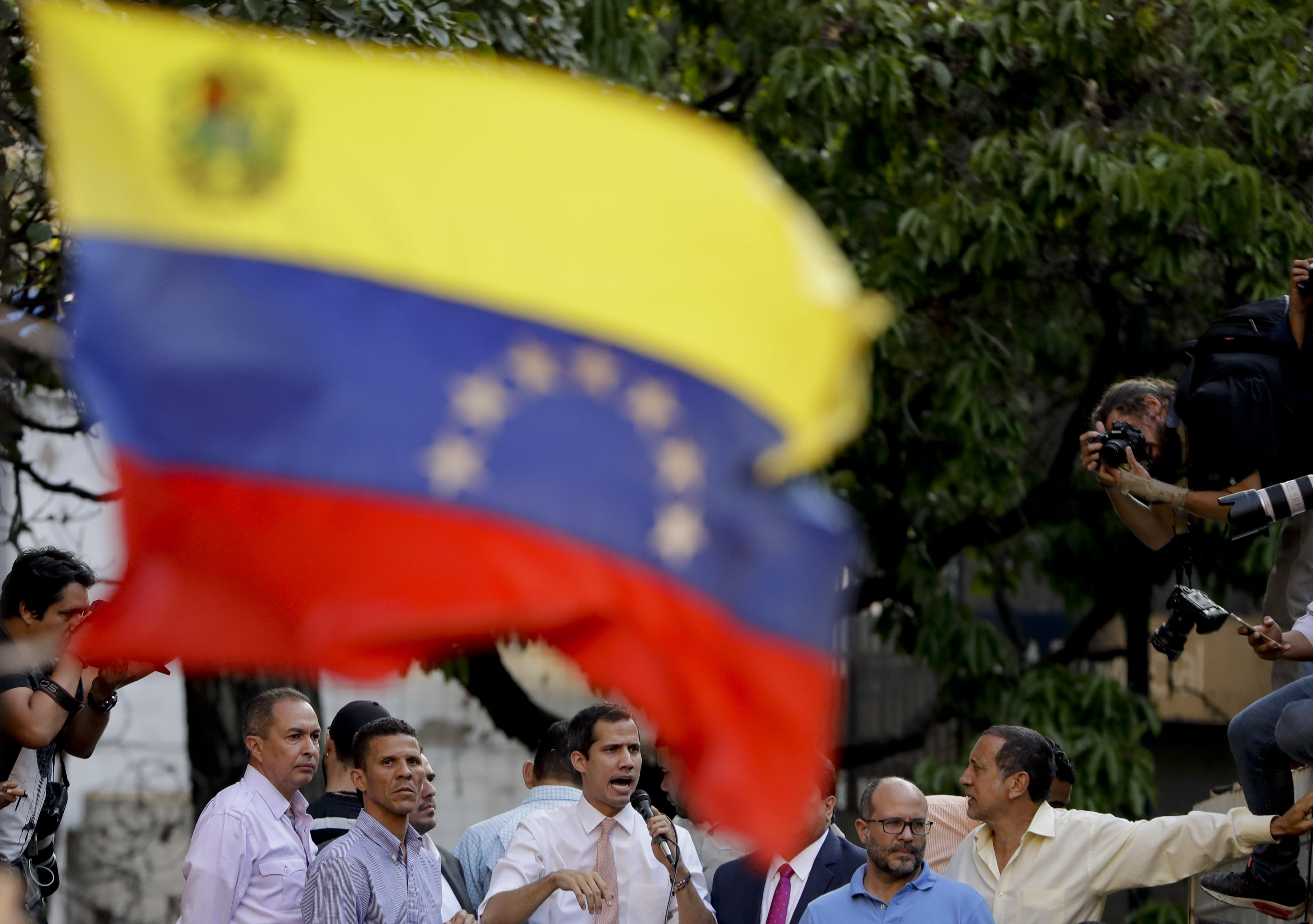 """Venezuela's opposition leader and self-proclaimed interim president Juan Guaido talks during a rally in Caracas, Venezuela, Monday, April 1, 2019. He's backed by more than 50 nations, which consider Nicolas Maduro's presidency illegitimate following what they call sham elections last year. """"We must unite now more than ever,"""" said Guaido earlier in the day. """"We must mount the biggest demonstration so far to reject what's happening."""" (AP Photo/Natacha Pisarenko)"""