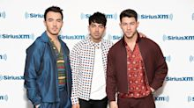 Fans declare 'grown-up and sexy' Jonas Brothers comeback shoot the 'best thing on the Internet'