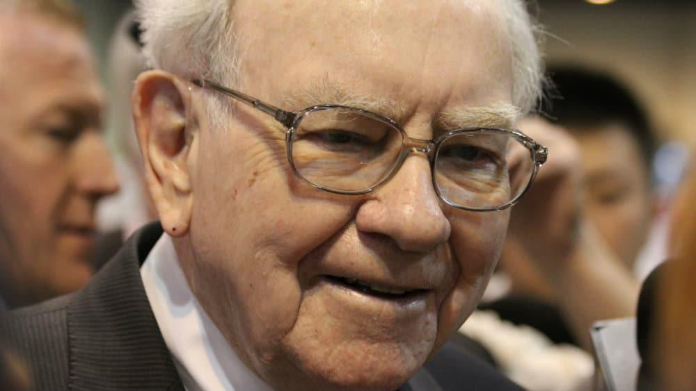 Forget Bitcoin! I'd listen to Warren Buffett and invest £250 a month in an ISA to retire rich