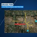 Grass fire destroys two outbuildings in Fresno County, blaze contained