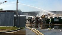 Huge fire burns at west Houston recycling facility