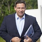Florida school district drops mask mandate after DeSantis threatens to withhold funding