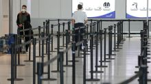 Canada to require most airport workers, flight crews to wear masks