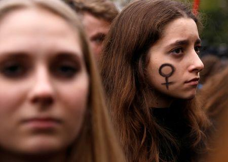 A woman looks on as people gather to protest against plans for a total ban on abortion in front of the ruling party Law and Justice (PiS) headquarters in Warsaw, Poland. REUTERS/Kacper Pempel