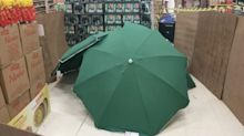 Supermarket covers worker's dead body with umbrellas as customers continue to shop