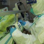 China locks down 14 cities as Wuhan coronavirus spreads