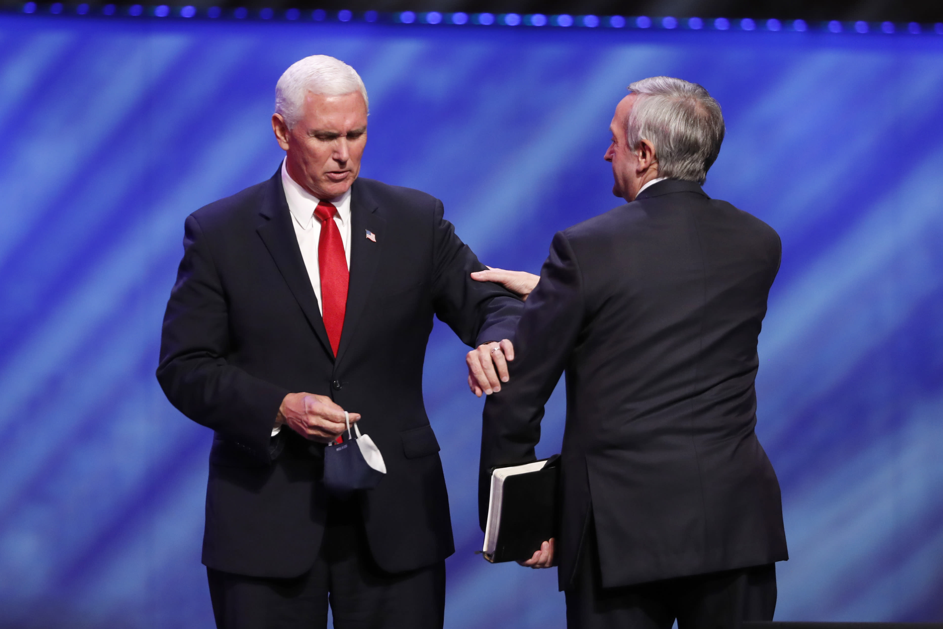 Vice President Mike Pence, left, greets Senior Pastor Dr. Robert Jeffress, right, after Pence spoke at the Southern Baptist megachurch First Baptist Dallas during a Celebrate Freedom Rally in Dallas, Sunday, June 28, 2020. (AP Photo/Tony Gutierrez)