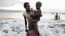 The Pacific Islands are drowning under rising sea levels. These stunning photos show their precarious way of life.