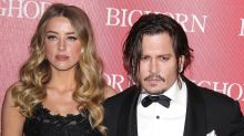 Amber Heard Claims That Johnny Depp Is 'Delaying' Their Divorce