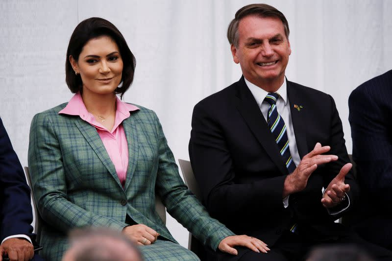 Brazilian President Jair Bolsonaro and his wife Michelle Bolsonaro attend a meeting with the Brazilian community at The Miami Dade College Auditorium, in Miami