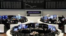 European shares tick lower, but defensive buying caps losses