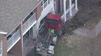 Truck cab crashes into condos in Macomb Township